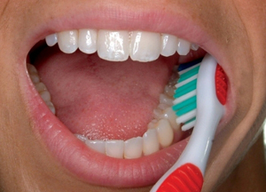 1) Place the toothbrush against your gumline at a 45-degree angle. Move the brush back and forth gently in short (tooth-wide) strokes.