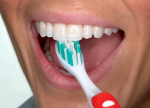 5) Use the top part of the brush to clean the inside surface of the top and bottom front teeth. Use a gentle up-and-down motion.